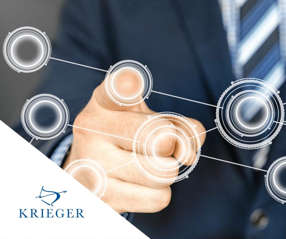 Finger der sich über virtuelle Punkte bewegt mit KRIEGER Logo seitlich.